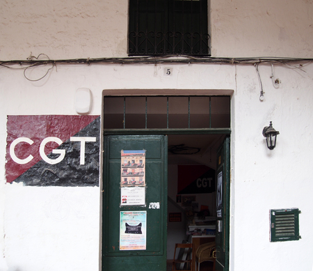 Ciutadela, Menorca , Spain - October 1 2018: The office of the CGT trade union with banner painted on the wall of the local branch office in Ciutedella Menorca Editorial