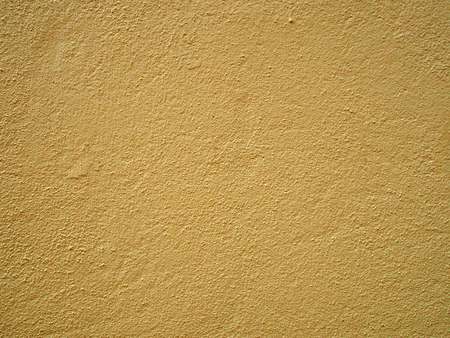 a pale yellow concrete grainy textured wall painted a bright light yellow color Stock fotó