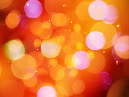 Beautiful glowing orange blurred lights glittering warm abstract with glitter effect