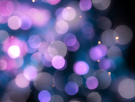 purple blurred soft round shiny blurred lights abstract with bright sparkles on a black background