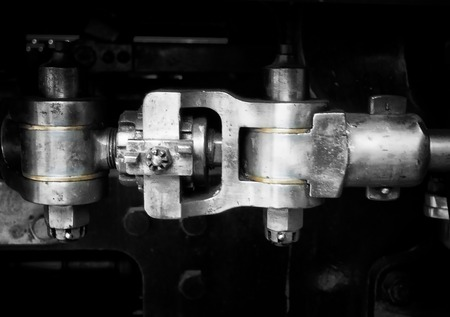 detail of old steel mechanical coupling with brass joints Stock Photo