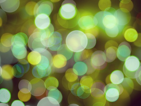glowing blurred yellow and green soft bright lights party effect background