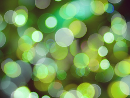 glowing green and white round blurry soft abstract glowing lights background