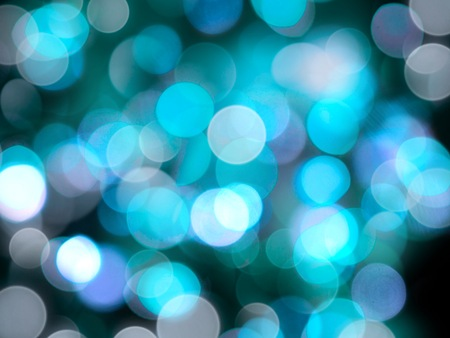 a bright blue and white defocused glittering round blurred lights abstract shining background