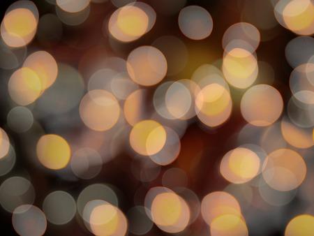 round orange glowing blurred lights on a black night background