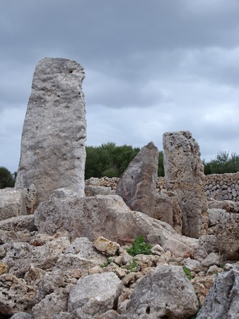 The Talaiotic village of Trepuco Minorca Balearic Islands showing a large megalith and taula in the background