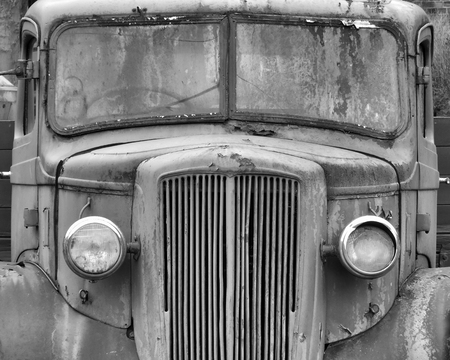 a monochrome front view of an old abandoned rusty 1940s truck Stock Photo
