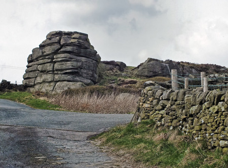 great rock a large gritstone outcrop in todmorden west yorkshire near a surrounding country lane and walls