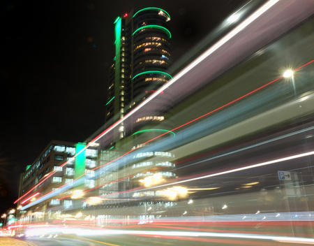 Blurred lights lest by moving traffic at night in bridgewate place leeds Stock Photo