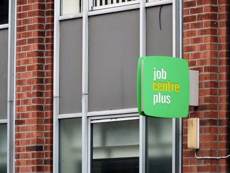 leeds, england - 13, sepetmber, 2018: a sign outside a job centre plus in leeds england run by the UK Department for Work and Pensions for its working-age support service and encourage employment 에디토리얼