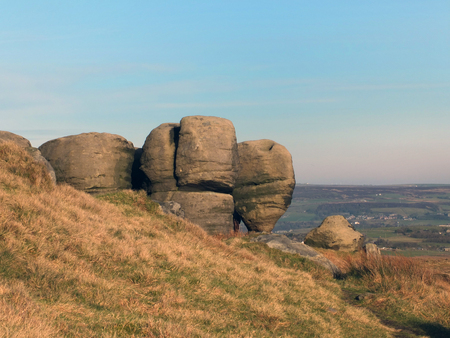 the bridestones a large group of gritstone rock formations in west yorkshire landscape near todmorden against pennine countryside