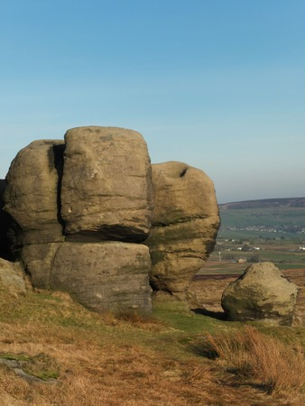 the large group of boulders at the bridestones a large group of gritstone rock formations in west yorkshire landscape near todmorden against pennine countryside