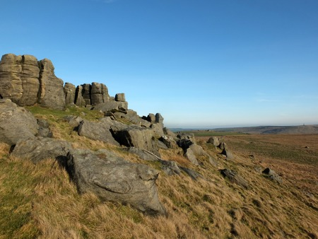 panoramic view of a large rugged gritstone outcrop at the bridestones a large rock formation in west yorkshire near todmorden Archivio Fotografico