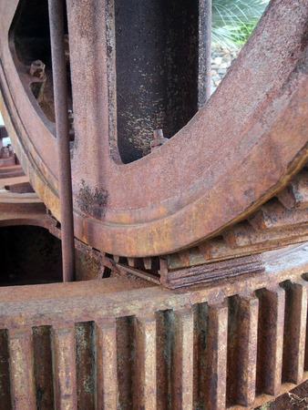 close up details of large old rusty steel industrial cog wheels