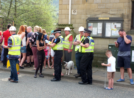 hebden bridge, west yorkshire, england - 22 april 2019: police community support officers talk to people at the annual easter monday charity duck race in hebden bridge Sajtókép