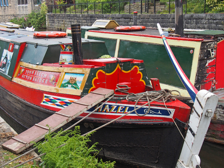 hebden bridge, west yorkshire, england - 23 may 2019: a close up of old barges at the narrow boats club gathering held on the may bank holiday on the rochdale canal at hebden bridge in west yorkshire