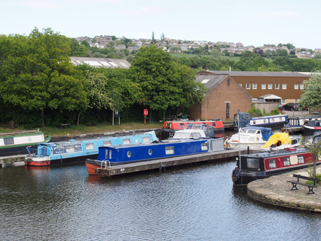 brighouse, west yorkshire, united kingdom: 24 may 2017: a view of brighouse basin boats and moorings on the calder and hebble navigation canal in calderdale west yorkshire