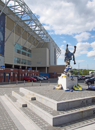 leeds, west yorkshire, united kingdom - 16 may 2019: elland road football stadium the home of leeds united witth bremner square decorated with team scarves and shirts on the day after the championship playoffs on 15th may 2019