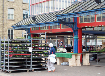 huddersfield, yest yorkshire, United Kingdom - 20 May 2019: women shopping for garden plants on a stall in huddersfield market in west yorkshire