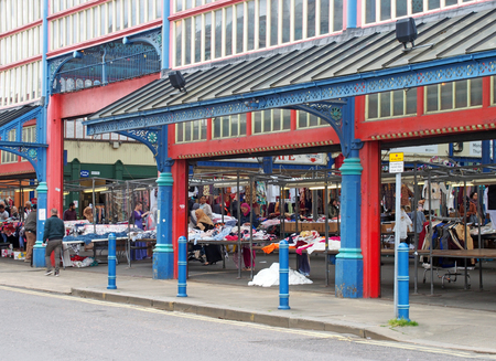 huddersfield, west yorkshire, United Kingdom - 20 May 2019: people walking and shopping at stalls in huddersfield market in west yorkshire Editöryel