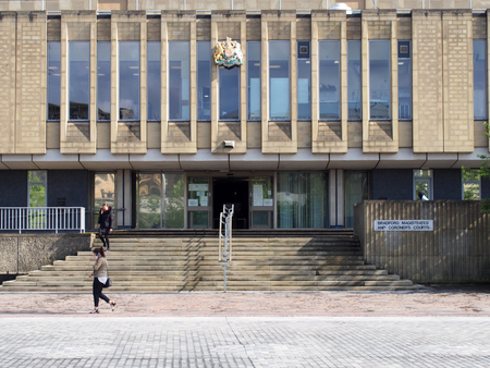 bradford, west yorkshire, united kingdom - 28 may 2019: pedestrians walk past the front of bradford magistrates court in west yorkshire in centenary square