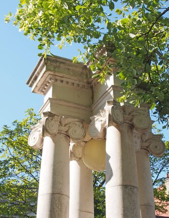 ornate classical columns used as street lighting surrounded by trees near the town hall in lord street southport merseyside