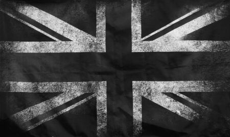 a monochrome full frame image of an old stained dirty union jack british flag with dark crumpled edges 版權商用圖片