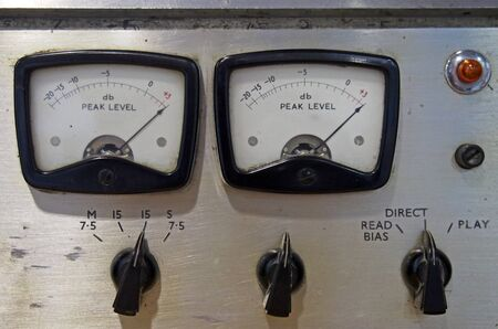 a close up of two old decibel meters on an old vintage reel to reel tape recorder with control knobs and switches Banque d'images
