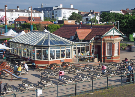 southport, merseyside, united kingdom - 28 june 2019: people relaxing in the waterfront cafe a famous restaurant and bar in southport merseyside 報道画像