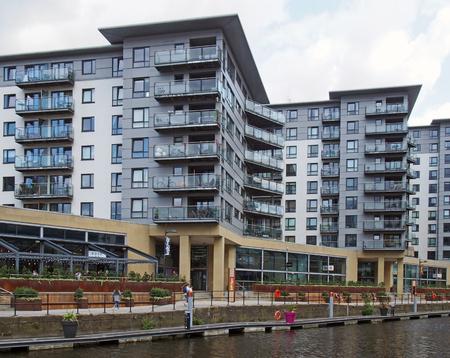 leeds, west yorkshire, united kingdom - 16 july 2019: modern apartment developments and waterside bars around leeds dock