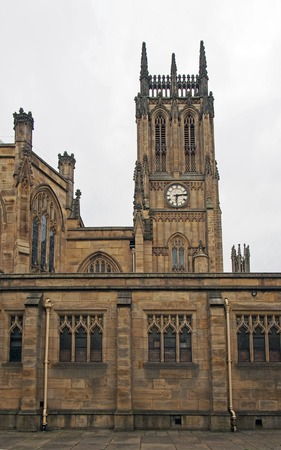 a side view of leeds minster with tower and architectural details from the street