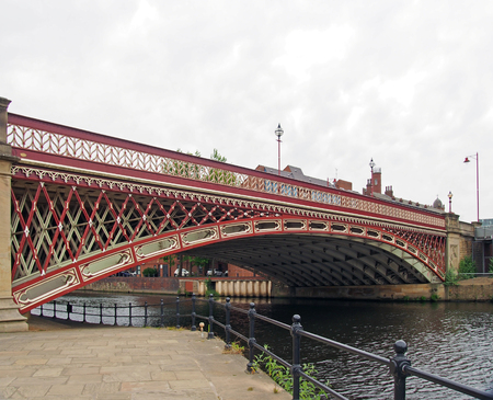 crown point bridge crossing the river aire in leeds a single span fretted cast iron construction opened in 1842 taken from the riverside path
