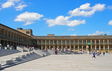 halifax, west yorkshire, united kingdom - 23 july 2019: the piece hall in halifax west yorkshire in summer with blue cloudy sky and people enjoying the summer sunshine