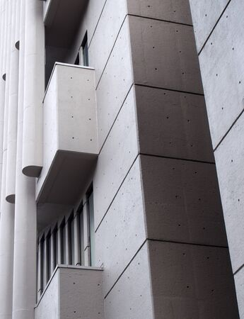 angles corners and geometric shapes on the exterior wall of a 1960s concrete brutalist building