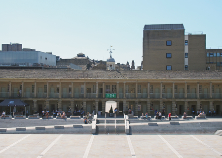 halifax, west yorkshire, united kingdom - 23 july 2019: people relaxing shopping and enjoying the summer sunshine in the square of halifax piece hall in west yorkshire