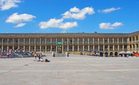 halifax, west yorkshire, united kingdom - 23 july 2019: people relaxing on the steps and walking across the square of halifax piece hall in west yorkshire