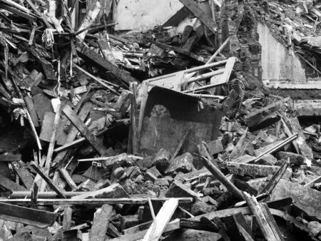 monochrome image of a collapsed burned building with piles of rubble and debris Reklamní fotografie