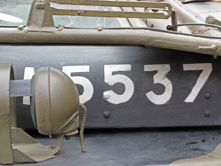 white numbers on the hood of a vintage American world war 2 vehicle with white letters and headlamp detail Reklamní fotografie