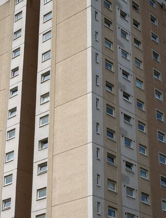 a view of a typical british council built high rise concrete apartment block typical of public housing in the uk