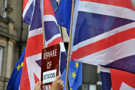 leeds, west yorkshire, united kingdom - 29 august 2019: british and european flags with the slogan beware of dictators at the leeds for europe anti brexit demonstration Editorial