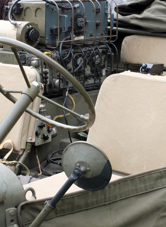close up of the driving wheel and radio equipment in a vintage world war 2 american military vehicle