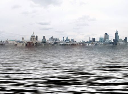manipulated conceptual image of the city of london with buildings flooded due to global warming and rising sea levels and gulls