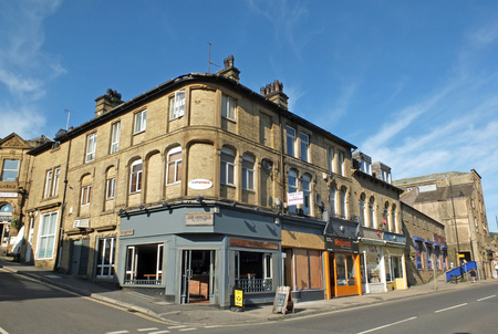 sowerby bridge, west yorkshire, united kingdom - 14 september 2019: shops and buildings on high street in sowerby bridge in west yorkshire