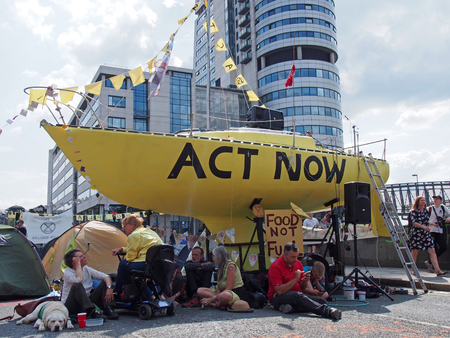 leeds, west yorkshire, united kingdom - 16 july 2019: the large yellow boat banners and people in the road at the extinction rebellion protest blocking victoria bridge in leeds