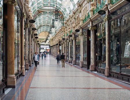 leeds, west yorkshire, united kingdom - 16 july 2019: people shopping in county arcade a historic victoria shopping area in the victoria quarter in leeds
