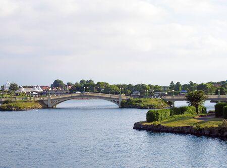 southport, merseyside, united kingdom - 28 june 2019: people on the venetian bridge crossing the lake in the kings gardens in southport merseyside