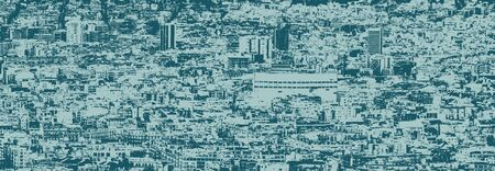 blue duotone colorized panoramic aerial cityscape view of barcelona showing the dense crowded modern urban environment Фото со стока