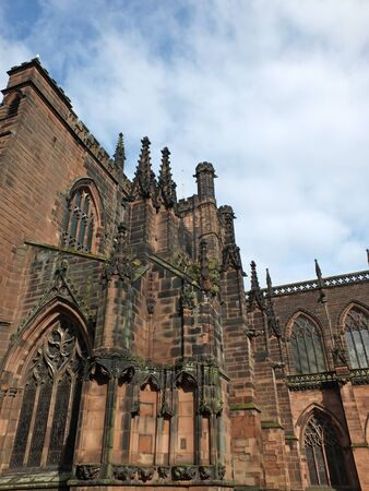 close up view of ornate medieval stonework on the historic chester cathedral Фото со стока