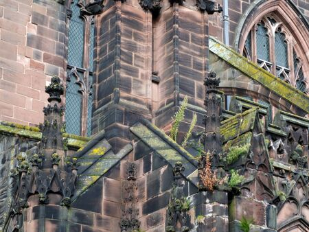 close up view of ornate moss covered medieval stonework on the historic chester cathedral