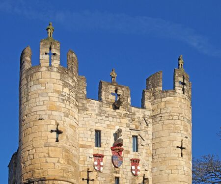 a close up of the top of Micklegate Bar the 12 century gatehouse and southern entrance to the city of york